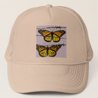 Monarch butterfly  behind barbed wire trucker hat