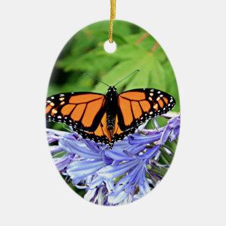 Monarch butterfly in garden ceramic ornament