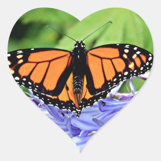 Monarch butterfly in garden heart sticker