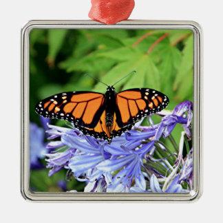 Monarch butterfly in garden metal ornament