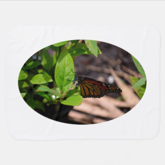 monarch butterfly on green leaf plant baby blankets