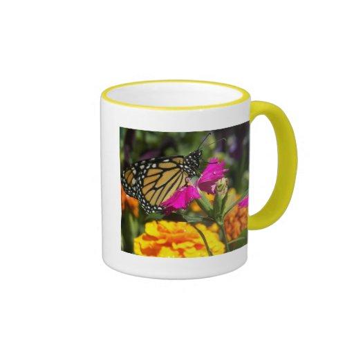 Monarch butterfly on pink marigold-mug
