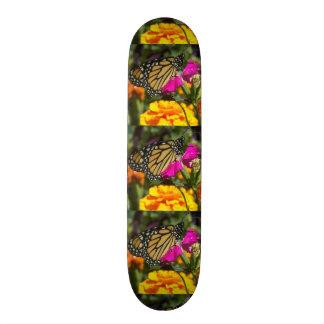 Monarch butterfly on pink marigold-skateboard skateboard