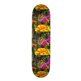 Monarch butterfly on pink marigold-skateboard skateboard deck
