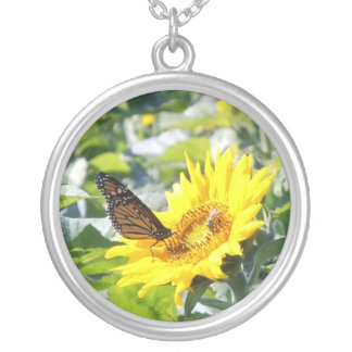 Monarch butterfly on sunflower. silver plated necklace