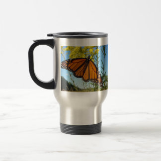 Monarch butterfly spreads his wings travel mug