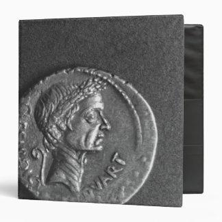 Moneda con un retrato de Julio César