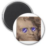 Moneda en gafas de sol imán
