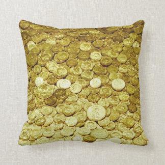 monedas de oro cojines