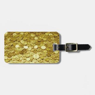 monedas de oro etiquetas maletas