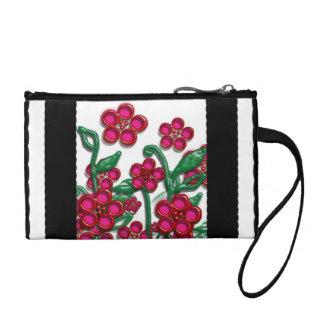 monedero negro y blanco con las flores rosadas