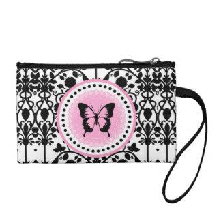 Monedero rosado y negro de la mariposa
