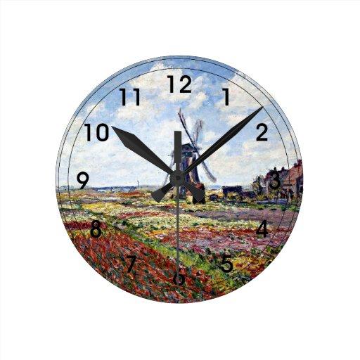 Monet - campos de tulipanes con el molino de vient relojes de pared