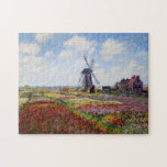 "Monet Field of Tulips With Windmill Puzzle<br><div class=""desc"">Monet Field of Tulips with Windmill puzzle. Oil painting on canvas from 1886. One of Monet's most colorful works painted around the Rijnsburg Windmill. The tulip fields are bursting with reds, whites, yellows and greens. A beautiful landscape painting that makes a great gift for fans of Claude Monet, tulips, impressionism,...</div>"