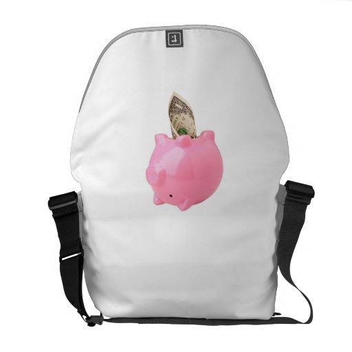 Money out of a piggy bank messenger bags
