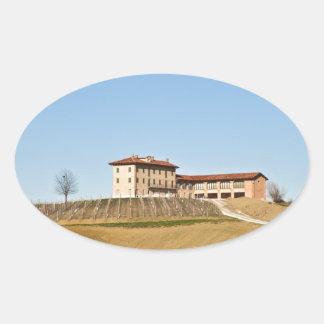 Monferrato under a blue sky oval sticker