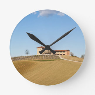 Monferrato under a blue sky round clock