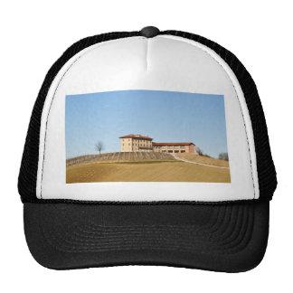 Monferrato under a blue sky trucker hat