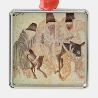 Mongolian nomads with a donkey, 15th century metal ornament