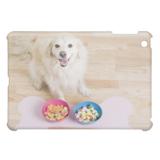 mongrel sitting in front of two bowls with dog iPad mini covers