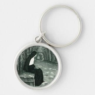 monja solitaria llavero redondo plateado