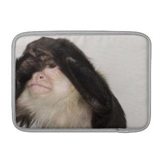 Monkey covering its eyes MacBook sleeve