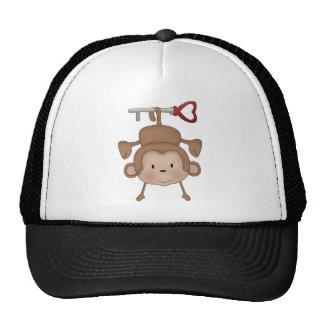 Monkey hanging on heart key trucker hat