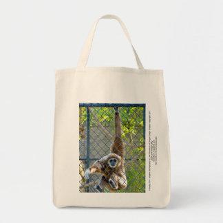 Monkey in zoo habitat tote bag