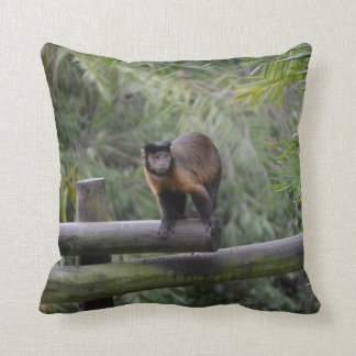 monkey on railing sad primate throw pillow