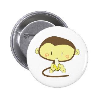 Monkey peeling a banana button