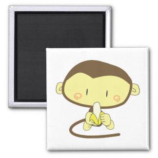 Monkey peeling a banana magnet
