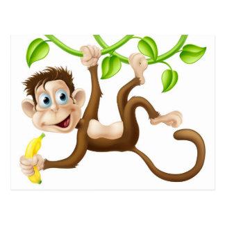 Monkey swinging with banana post card