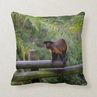 monkey turned away on railing throw pillow