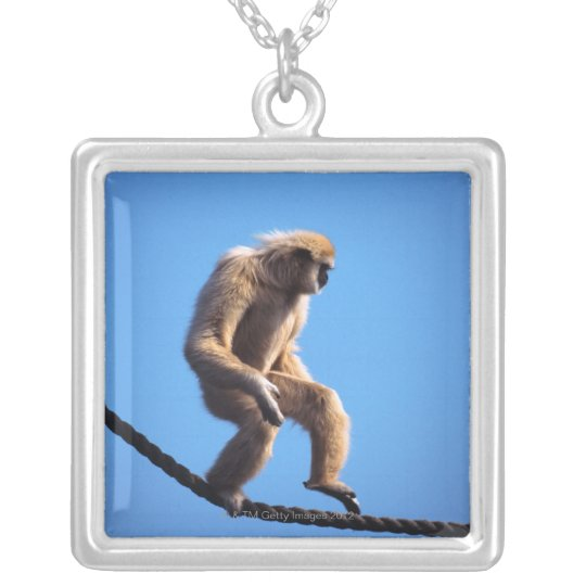 monkey walking on rope silver plated necklace