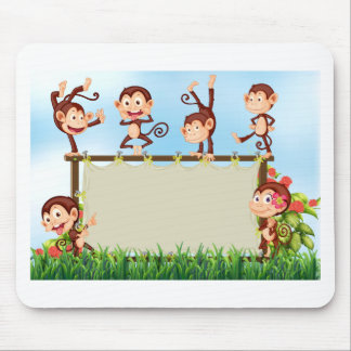 Monkeys and sign mouse pad