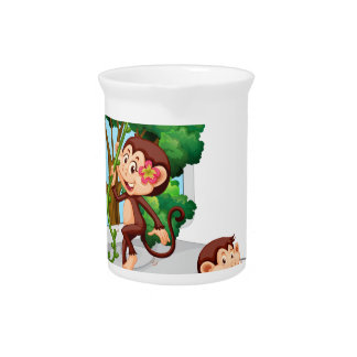 Monkeys playing and eating on computer screen beverage pitcher