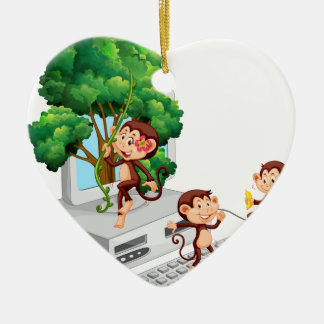 Monkeys playing and eating on computer screen ceramic ornament