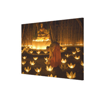 Monks lighting khom loy candles and lanterns for canvas print