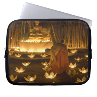 Monks lighting khom loy candles and lanterns for computer sleeve