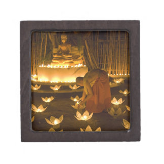 Monks lighting khom loy candles and lanterns for jewelry box