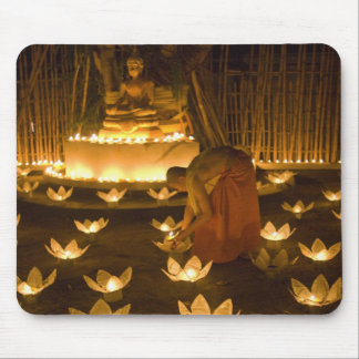 Monks lighting khom loy candles and lanterns for mouse pad