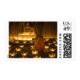 Monks lighting khom loy candles and lanterns for stamps