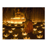 Monks lighting khom loy candles and lanterns for postcard