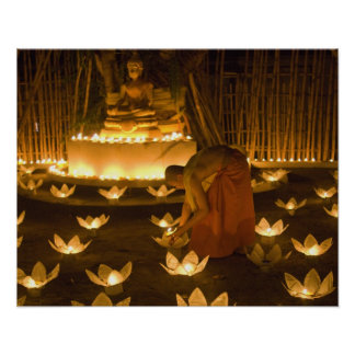Monks lighting khom loy candles and lanterns for poster