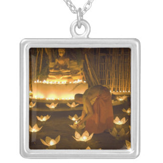 Monks lighting khom loy candles and lanterns for silver plated necklace
