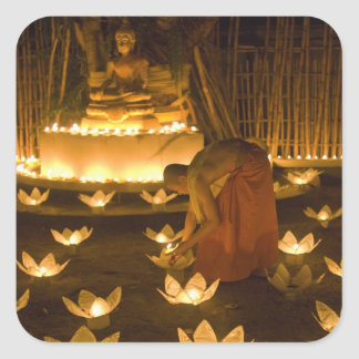 Monks lighting khom loy candles and lanterns for square sticker