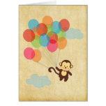 Mono adorable que se va volando con los globos tarjeton
