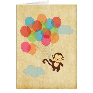 Mono adorable que se va volando con los globos tarjeta pequeña