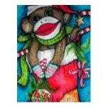 Mono alegre del calcetín del acebo tarjetas postales