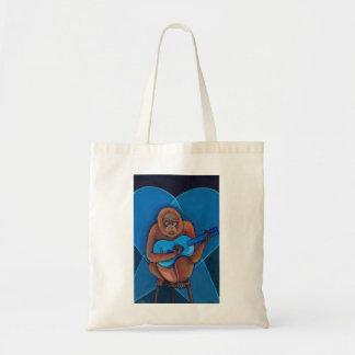 Mono azul divertido del guitarrista del arte del m bolsa lienzo